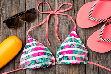 Colorful swimsuit on wooden background