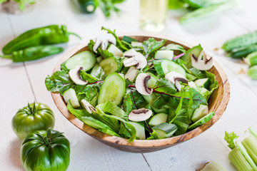 vegetable green salad bowl on kitchen table, balanced diet