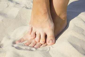 feet on the sand of a beach
