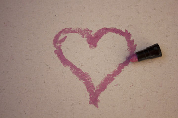 The heart which is painted with red lipstick on a light background