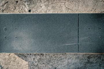Skateboard on concrete floor in skatepark