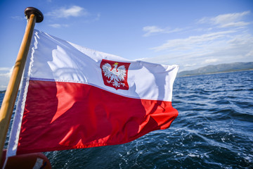 Polish flag waving while sailing on a yacht in the north sea