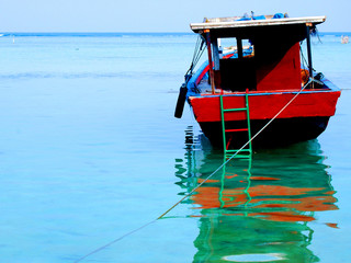 Red boat at sea