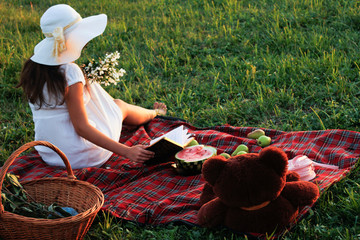 Picnic on a green meadow in the summer