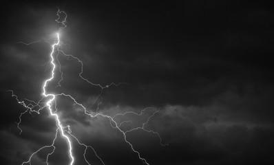 Fork lightning striking down during summer storm