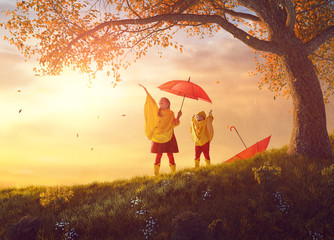 children under the autumn shower