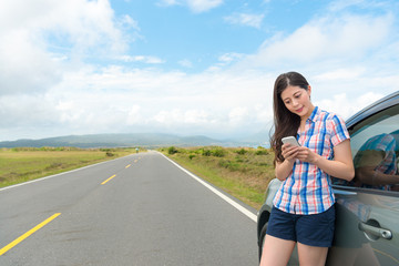 beautiful young female traveler stopping car