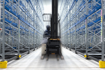 Refrigeration and freezing warehouse with stacker truck inside moving