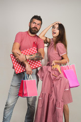 Shopping and fashion concept. Couple holding shopping bags