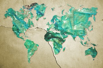 World map in dirty and burned plastic surface on cracked wall. Pollution concept. Elements of this image furnished by NASA.