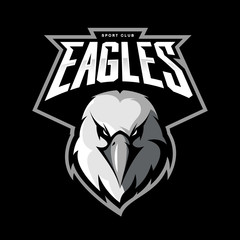 Furious eagle head athletic club vector logo concept isolated on black background.  Modern sport team mascot badge design. Premium quality bird emblem t-shirt tee print illustration.