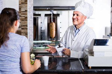 man chef  taking order from customer