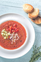 Portion of gazpacho on the wooden table