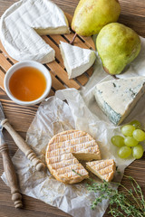 Moldy cheese with pears and grape