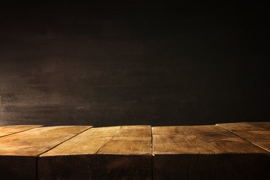 wooden table and blackboard background. Ready for product display montage