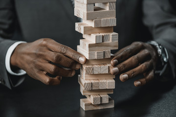 african american businessman with blocks wood game