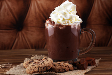 hot chocolate with cocoa and chocolate chip cookies.