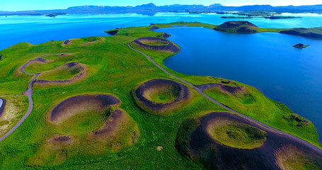Volcanic Craters In Green Plains By Blue Water Bay - Myvatn, Iceland