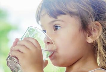 Child drinks water.