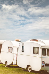 Row of three vintage restored caravans
