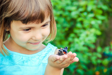 Child with a butterfly. Selective focus.