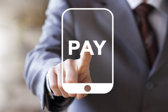 Businessman press button PAY on smartphone.