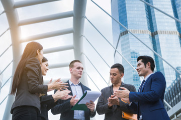 Business team glad and clap to leader
