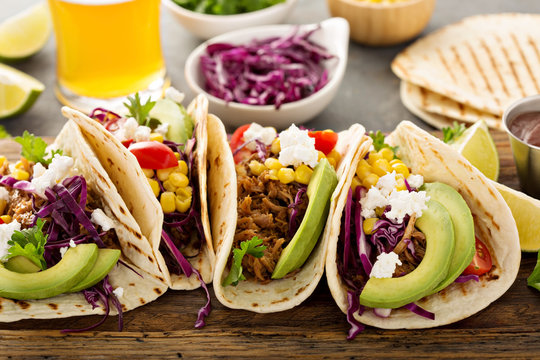 Pulled pork tacos with red cabbage and avocados