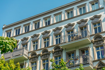 luxury facade with ornaments and steel balconies
