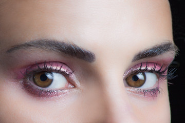 woman eyes with perfect pink  wet eyeshadow closeup studio