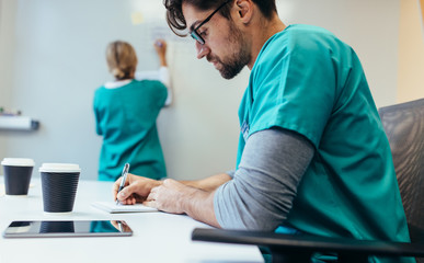 Healthcare worker working in hospital boardroom