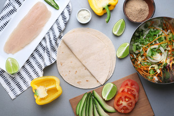 Ingredients for fish tacos on grey background