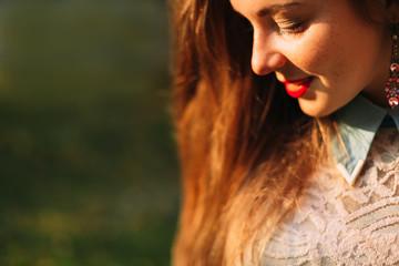 Closeup portrait of a pretty girl with enigmatic inscrutable smi