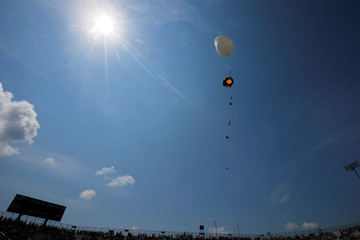 A scientific balloon is released for the solar eclipse at the football stadium at Southern Illinois University in Carbondale