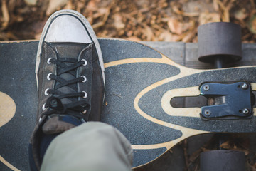Close up of a male's foot on a longboard
