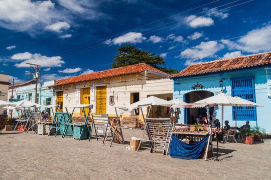 CAMAGUEY, CUBA - JAN 25, 2016: Colorful houses and souvenir stalls at San Juan de Dios square in Camaguey
