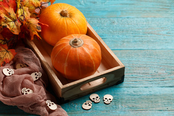 Pumpkins, brown cloth, maple leaves