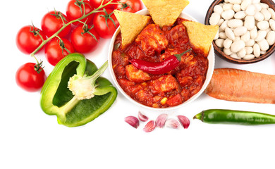 Composition with delicious turkey chili and ingredients on white background