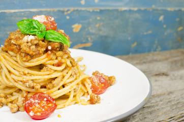 Italian spaghetti bolognese on wood background