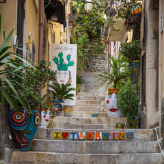 "Romantic street of Corso Umberto in beautiful town of Taormina with ""I love Taormina"" writing, Sicily island, Italy"