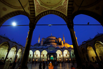 People walk at the courtyard of the Ottoman-era Sultanahmet Mosque in Istanbul
