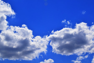 Clouds over blue sky in summer day