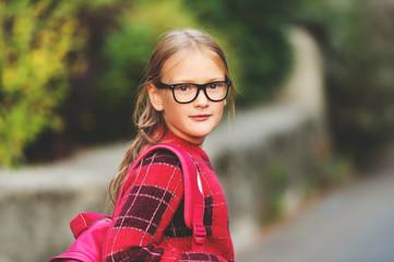 d63dd9cb29cb Outdoor portrait of a cute little 9-10 year old girl wearing blue ...