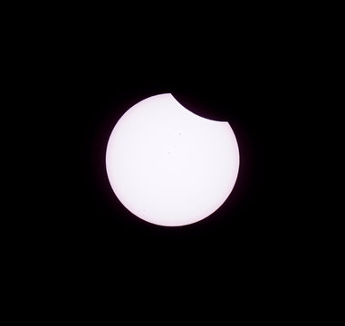 The moon start passes in front of the sun during a solar eclipse seen from Guernsey