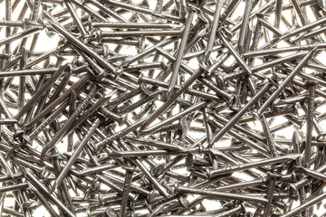 Many steel nails on white background
