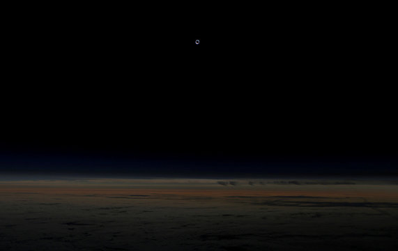 The sun is obscured by the moon during a solar eclipse as seen from an Alaska Airlines commercial jet at 40,000 feet above the Pacific Ocean off the coast of Depoe Bay, Oregon, U.S.