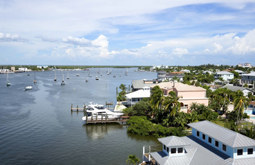 Aerial view of homes and boats in Matanzas Harbor on Fort Myers Beach, Florida, USA.