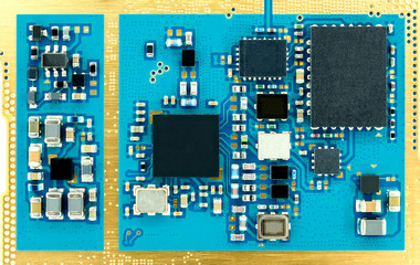 Top view and close-up image of microprocessor on electronic circuit board.