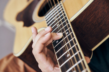 Man plays the guitar, music, musical instruments, strings