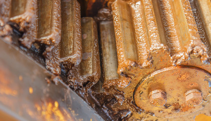 Close-up gear of machine in industry energy oil and gas in sea offshore .